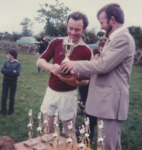 Conor Gavin presents the FR.Rafferty Cup to Pat McWalter in 1982